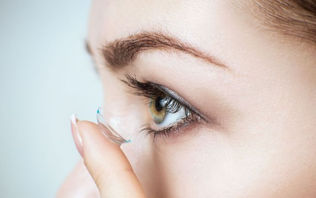 Woman putting on contacts